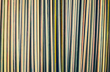 Bamboo sticks background. Vertically arranged.