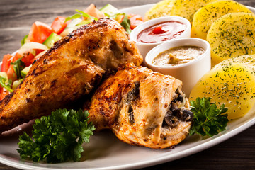 Roasted chicken fillets and vegetables