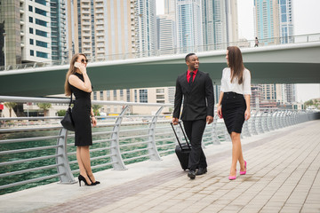 Business people in a big city, having a conversation.