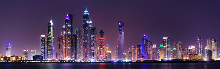 Amazing night panorama of Dubai Marina. Multiple highest skyscrapers of the world with residential buildings, Dubai, United Arab Emirates