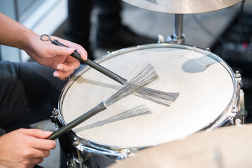 drummer playing at drums set