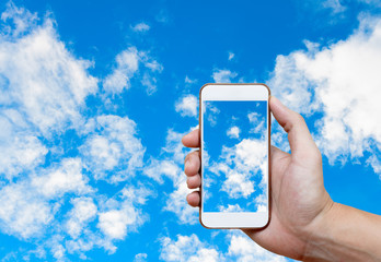 Man hand holding and screen shot blue sky background with white
