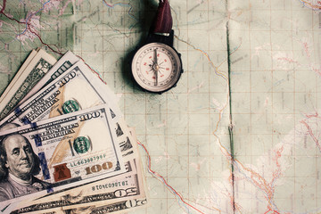 wanderlust and planning summer travel vacation concept, compass