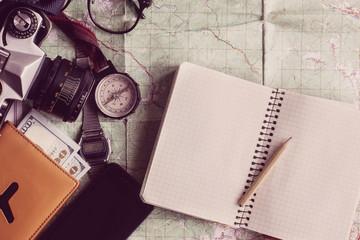 wanderlust and adventure concept, compass camera glasses passpor