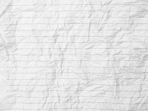 Crumpled sheet of lined paper or notebook paper