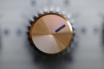 close up of golden knob guitar amplifier