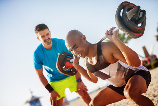 Fitness people at the beach, working out.