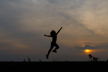 Silhouette girls on holiday. she is happy to be running and jump