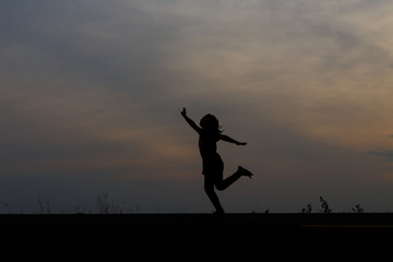 Foto op Canvas Jacht Silhouette girls on holiday. she is happy to be running and jump