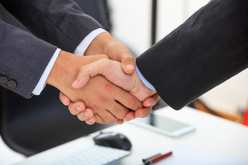 Close up of business handshake