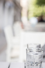 detail of a water in a glass cup with ice. space for lettering, copy and text