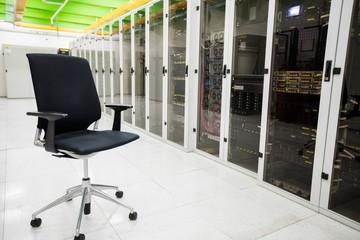 Empty chair in corridor