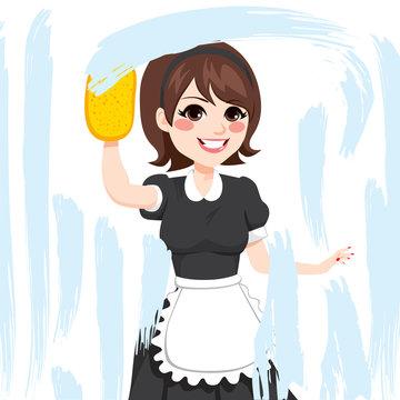 Beautiful brunette caucasian woman in maid dress working cleaning window with soap sponge