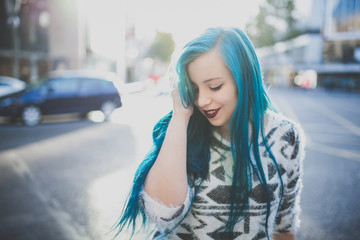 Young girl with blue hair.