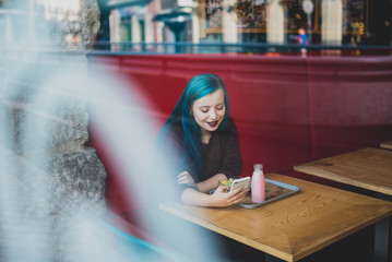 Girl sitting in beanery.