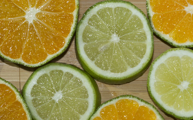 Slices of mandarine and lime on the cutting board