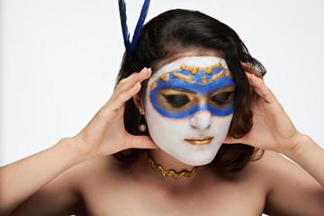 woman take out mask