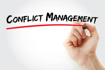 Hand writing conflict management with marker, concept background