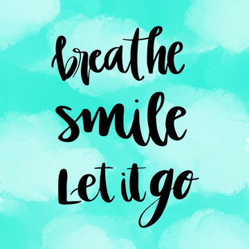 Breathe, smile, let it go inspirational message on blue painted background