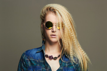 hipster blond Sexy girl in sunglasses.beautiful young woman in jeans and accessories