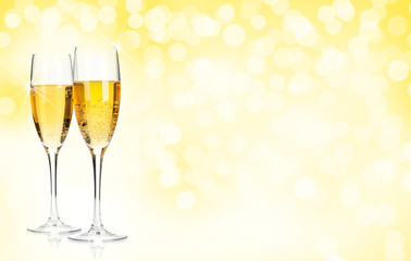 Two champagne glasses over christmas background