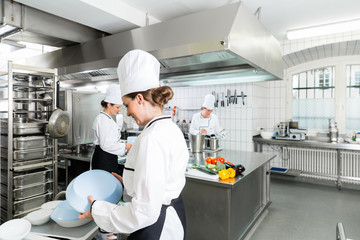 Canteen kitchen with chefs during service