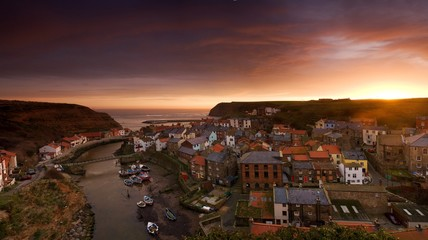 Coastal town at sunset, Staithes, Yorkshire, England, UK