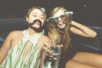 Party girls celebrate in Hollywood drinking champagne