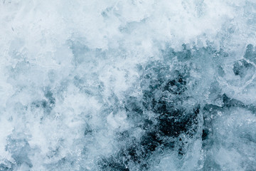 White foam on a sea water surface of the Barents sea