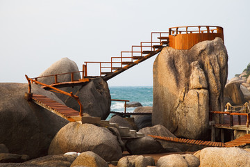Wooden Boardwalk And Lookout On The Rocks Along The Ocean; Koh Tao Thailand