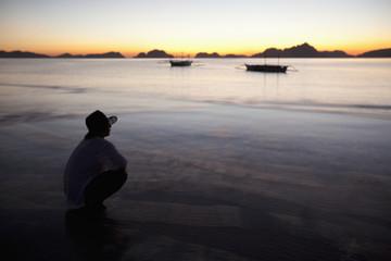 A Man On A Beach At Sunset; Corong-Corong, Palawan, Philippines