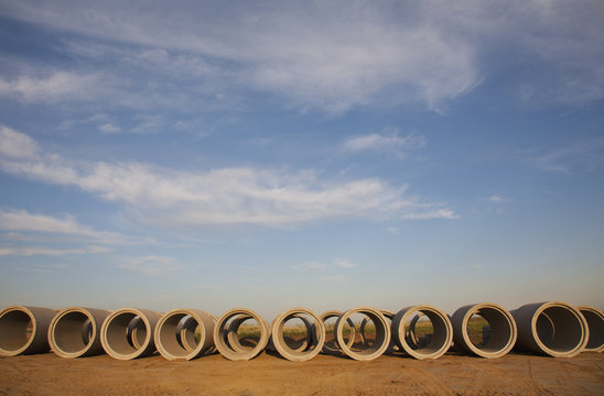 Row Of Storm Sewer Pipes; St. Albert, Alberta, Canada