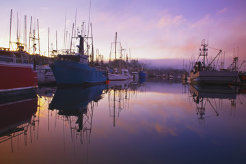 Sunrise Through The Morning Fog And Fishing Boats In Newport Harbor; Newport, Oregon, United States of America