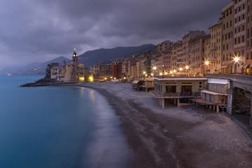 Buildings Illuminated Along The Coast At Night; Camogli, Liguria, Italy