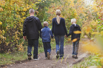 Family Walking Together On A Path In A Park In Autumn; Edmonton, Alberta, Canada