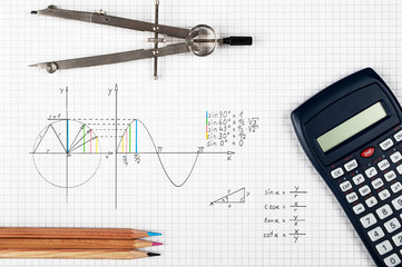 Engineering concept, sine function - calculator, compass and coloring pencils
