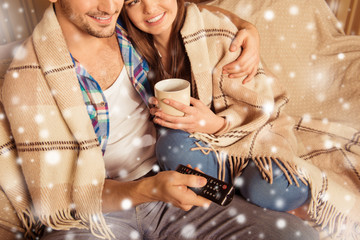 Close up of couple in love watching TV  in plaid on xmas