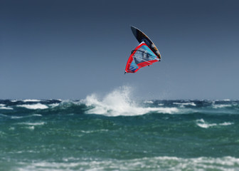 A Windsurfer Flips Upside Down Above The Water Off Punta Paloma; Tarifa, Cadiz, Andalusia, Spain