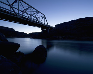 Silhouette Of A Bridge Going Over A River At Dusk; New Mexico, United States of America