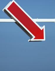 Red Arrow Sign Against A Blue Sky; Malaga Province. Spain