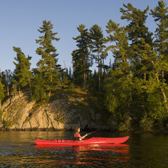 A Girl In A Red Kayak; Lake Of The Woods, Ontario, Canada