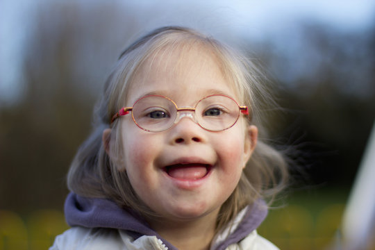A Young Girl With Down Syndrome Wearing Eyeglasses; Cambridge, United Kingdom