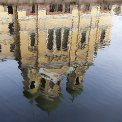 A Building Reflected In Griboedova Canal; St. Petersburg, Russia
