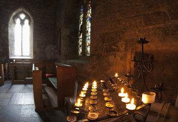 Candles Lit Inside A Church Sanctuary; Bamburgh, Northumberland, England
