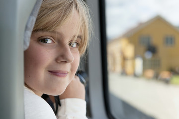 Portrait Of A Girl Sitting By The Window; Highlands, Norway