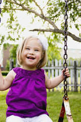 Young Girl With Down Syndrome On A Swing; Three Hills, Alberta, Canada