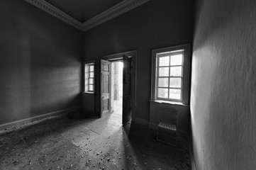 Light Shining Into A Dark Room Through An Open Door; North Yorkshire, England