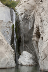 Waterfalls Along Rounded Cliff Rock In The Desert; Palm Springs, California, United States of America