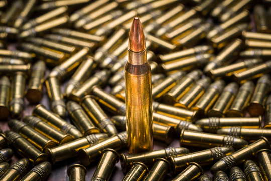 Selective focus on a single 223 caliber bullet in a background o