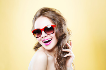 Portrait of a cheerful woman in sunglasses.